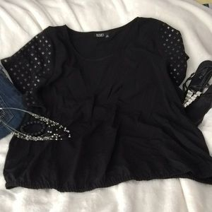 Gorgeous black silk like top with studded sleeves